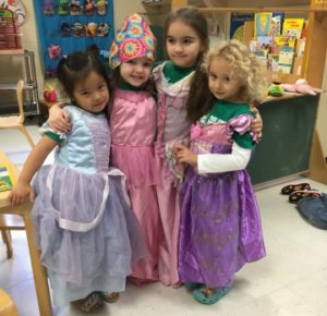 Four girls dressed up as princesses