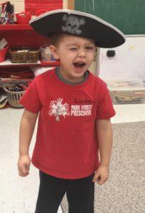 Boy wearing a pirate hat