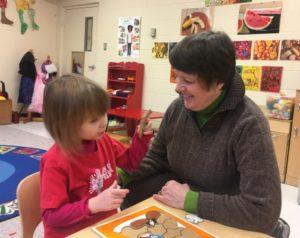 Woman volunteer helping child